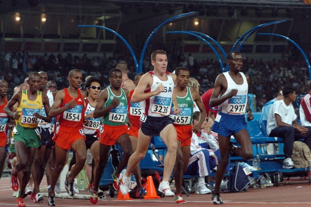 Then Oregon National Guard Capt. Dan Browne (Team USA No. 3235) dashes to the front of the pack in the 10,000 meters final of the 2004 Summer Olympic Games at Athens, Greece. Maj. Browne, a graduate of West Point and now coach of the U.S. Army World Class Athlete Program distance runners, finished 12th with a time of 28 minutes, 14.53 seconds.