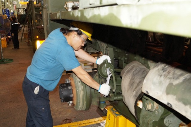 Min Su Yi, a mechanic in the Army Materiel Support Command-Korea's Tactical Wheeled Vehicle Team Four, tears apart a heavy expanded-mobility tactical truck fuel tanker. The vehicle's body, engine, transmission, and communications equipment will go to different work centers for simultaneous testing, repairs, cleaning, and paint.