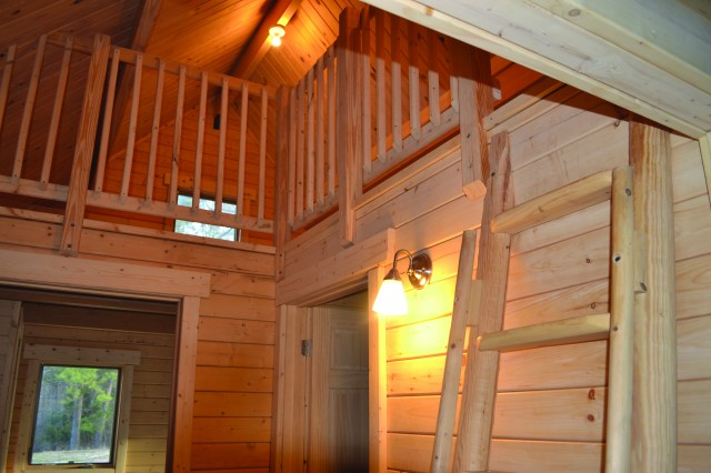 A ladder leads to a spacious loft in the new cabin.