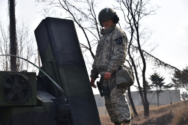 Pvt. Imaris Suarez stands atop a AN/TWQ-1 Avenger Missile System during a readiness drill at Osan Air Base, South Korea, Feb. 16. 2016.  Suarez, an air defense battle management system operator assigned to E Battery, 6th Battalion, 52nd Air Defense Artillery Regiment, from Ware, Mass., is learning how Patriot and Avenger systems work to provide layered air and missile defense on the Korean peninsula.