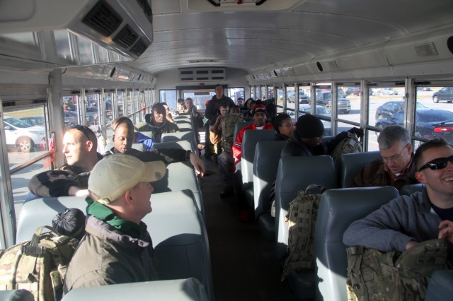 Soldiers of 3rd Battalion, 15th Infantry Regiment, 2nd Infantry Brigade Combat Team, 3rd Infantry Division, ride a bus from Fort Stewart, Ga., to Hunter Army Airfield Feb. 14, 2016. The Soldiers deployed to participate in Fearless Guardian II under Joint Multinational Training Group - Ukraine at the International Peacekeeping and Security Center in Yavoriv. (U.S. Army photo by Spc. Corey Foreman / Released)