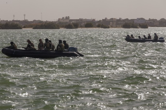 Senegalese Navy special operations forces ride in Zodiac boats during beach landing training in Saint Louis, Senegal, Feb. 11, 2016. The Senegalese Navy special operations forces were training with the Netherlands and U.S. Special Operations Forces as a part of Flintlock 2016. Flintlock is an African-led military exercise focused on security, counter-terrorism and military humanitarian support to outlying areas.