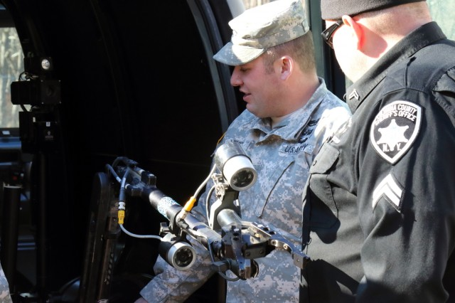 New York Army National Guard Staff Sgt. Adam Lendt, a Soldier in the 1108th Ordnance Company (Explosive Ordnance Disposal), explains the functions and capabilities of the TALON bomb disposal robot to a member of the Columbia County Sheriff's Office during a two-day training session with the Columbia-Greene County Shared Services Response Team at the 911 Call Center in Cairo, N.Y., Feb. 2, 2016. Four members of the 1108th instructed 20 local law enforcement officers on the types of improvised explosive devices and how to deal with them. (U.S. Army National Guard photo by Sgt. Michael Davis/Released)