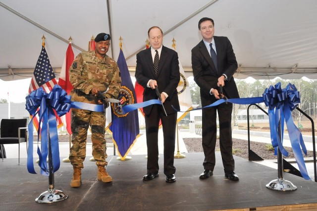 Redstone Arsenal Senior Commander Lt. Gen. Larry Wyche, U.S. Sen. Richard Shelby and FBI Director James B. Comey cut the ribbon celebrating the opening of the Terrorist Explosive Device Analytical Center at Redstone Arsenal Feb. 16.