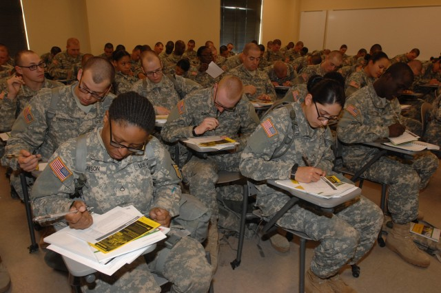 Basic Combat Training Soldiers with Company C, 84th Chemical Battalion, take the Military Saves Pledge during a financial presentation Feb. 11. Fort Leonard Wood leads the Department of Defense in Military Saves Week Campaign pledges. Military Saves Week is Monday through Feb. 27.