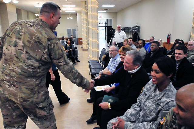 Maj. Gen. Kevin O'Connell, commanding general, U.S. Army Sustainment Command, congratulates the six awardees who he previously recognized during the Feb. 17 town hall. (Photo by Jon Micheal Connor, ASC Public Affairs)
