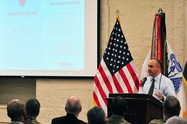 Joseph Castel, assistant deputy, G-1 (Personnel), Human Resource Management, ASC, briefs on voting assistance at the town hall Feb. 17. (Photo by Jon Micheal Connor, ASC Public Affairs)