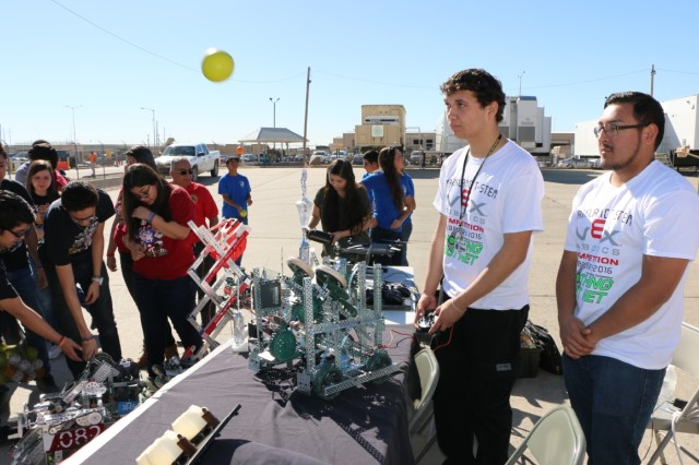 Students from Parkland High School show how their robot catapults foam balls into the air. The students visited the Integration Motor Pool at Fort Bliss, Texas in support of the Five Star STEM Cup Competition.