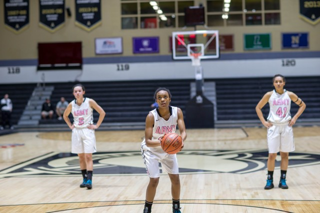 U.S. Military Academy at West Point Cadet, Destinee Morris, gets ready to shoot a free throw while Kelsey Minato (left) and Brianna Johnson look on. USMA at West Point Women's Basketball beat Holy Cross 80-49, Feb. 17 (Photo by Army West Point Athletics/all rights reserved.)