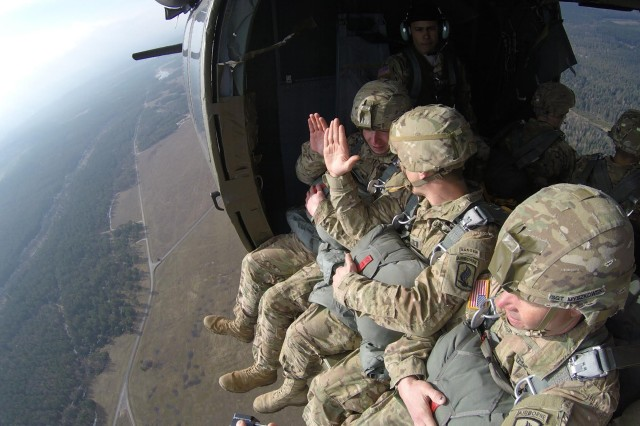 Sgt. Donald Greathouse, a 13B Howitzer Section Chief, with Bravo Company 4th Bn., 319th AFAR, takes the oath of reenlistment from his company commander, Capt. Luke Hudspeth, while on board a UH-60L Black Hawk helicopter from 3rd Battalion 227th Aviation Regiment, Task Force Spearhead, Feb. 18, 2016, at Bunker drop-zone Grafenwoehr, Germany. Paratroopers conducted over 200 airborne proficiency jumps from two UH-60L Black Hawk helicopters from 3rd Battalion 227th Aviation Regiment, Task Force Spearhead, Feb. 18, 2016, at Bunker drop-zone Grafenwoehr, Germany.
