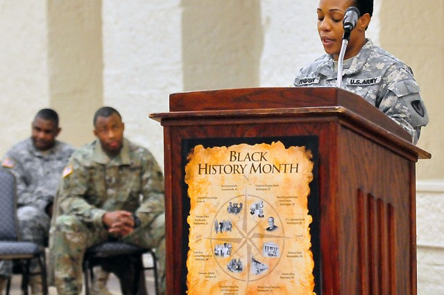"Sgt. 1st Class Michelle Ferguson, ASC, reads the presidential proclamation for ""National African American History Month"" at the observance Feb. 16 in Heritage Hall. (Photo by Jon Micheal Connor, ASC Public Affairs)"