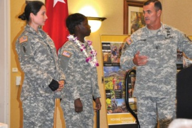 Maj. Gen. Charles Flynn, 25th ID commander, right, commends Spc. Julian Turner, center, for sharing her personal experience of receiving help during the 2015 Army Emergency Relief Fund Kickoff. This year's kickoff is scheduled for March 4 at the Nehelani, Schofield Barracks. (Photo by Karen Iwamoto, Oahu Publications)