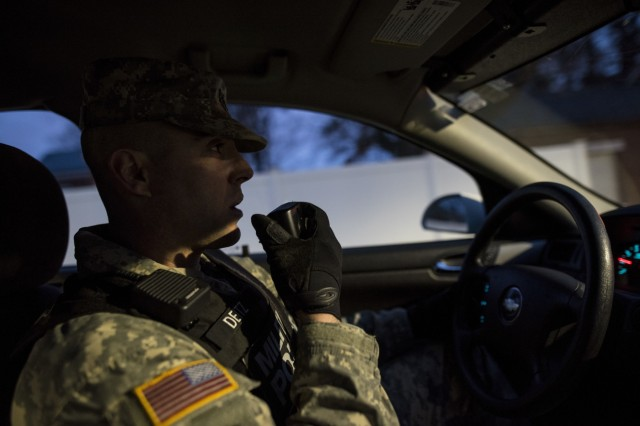 Staff Sgt. Micheal Deitz, patrol supervisor for the 289th Military Police Company, belonging to the 3rd U.S. Infantry Regiment (The Old Guard), calls in his location over the radio while on patrol in the Military District of Washington, Feb. 17. The 289th MP Company is currently operating a partnership with U.S. Army Reserve MP Soldiers from the 200th MP Command as part of a pilot program that began in early February, placing Army Reserve MPs on active duty orders for three weeks while working at Joint Base Myer-Henderson Hall, Fort Lesley J. McNair and the Arlington National Cemetery. Soldiers will also support the Military District of Washington with additional duty days throughout the year. (U.S. Army photo by Master Sgt. Michel Sauret)
