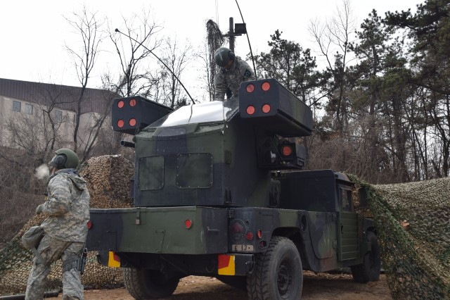 Pfc. Eli Schaap and Pvt. Imaris Suarez, air defense battle management system operators assigned to E Battery, 6th Battalion, 52nd Air Defense Artillery Regiment, emplace an Avenger Missile System during a readiness exercise at Osan Air Base, Feb. 16, 2016.  The Soldiers are part of a layered air defense exercise teaming Avenger short-range missile defense technology with Patriot ballistic missile defense capabilities.
