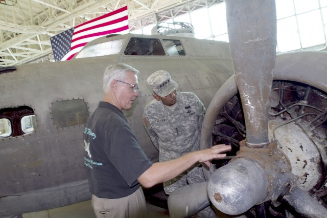 "U.S. Army Pacific commander Gen. Vincent K. Brooks visits the Pacific Aviation Museum on Ford Island to view the B-17 restoration underway. After receiving heavy fire during a strike on the Imperial Japanese Navy base on New Britain, the Army Air Forces bomber was forced to make an emergency landing on its way to Port Moresby, New Guinea. Pilot Capt. Frederick C. Eaton aimed for an open green field and set it down in what turned out to be the Agaiambo Swamp in 5 feet of water. There the ""Swamp Ghost"" sat until 2006, when efforts began to return it to U.S. soil. The Swamp Ghost arrived at the Pacific Aviation Museum on April 10, 2013, and preservation efforts are ongoing."