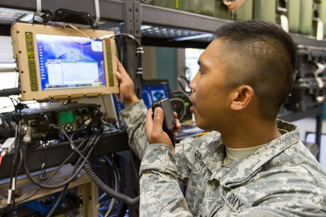 Spc. Adrian Quidachay, Signal Company, Headquarters and Headquarters Battalion, 25th Infantry Division, conducts data and chat communications with a Mobile User Objective System (MUOS) Feb. 18 on Schofield Barracks, Hawaii. The MUOS is military communications satellite that supports worldwide, multi-service users.