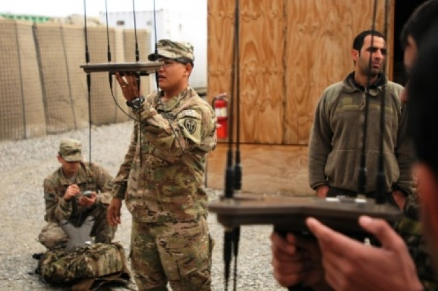 Staff Sgt. Marcos Falcones, left, leads a class of Afghan soldiers on a Wolfhound signal intelligence gathering system on Forward Operating Base Gamberi in Laghman province, Afghanistan, Jan. 25, 2014.
