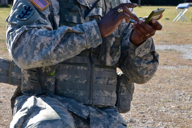 FORT HOOD, Texas -- Staff Sgt. Jason Johnson, an Observer Controller/Trainer with the 120th Infantry Brigade, Division West, applies camouflage to his face while performing a series of warrior tasks here Feb. 4. Johnson, along with three other Soldiers, participated in a 3-day competition for the title of best OC/T. The challenge consisted of a physical fitness assessment, 12-mile road march, obstacle course, and a hand-to-hand combat match. Soldiers received scores for each event and the highest combined score determined the winner.
