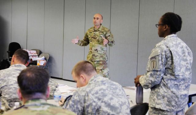 Staff Sgt. Eric Jimenez educates leaders