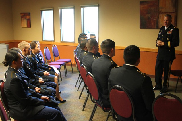 Brig. Gen. Jeffrey Gabbert speaks with cadets from the New Mexico State University ROTC Bataan Battalion Feb. 5 prior to a dinner ceremony at which he was inducted into the New Mexico State University Army ROTC Alumni Honor Company at Las Cruces, New Mexico. Gabbert, a 1986 graduate from the ROTC, is the commanding general for the Mission and Installation Contracting Command.