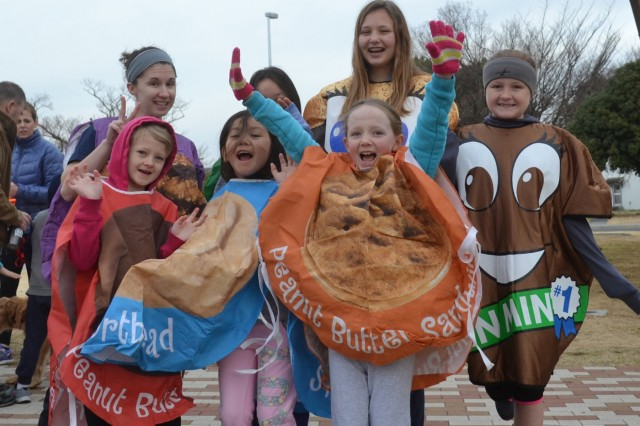 Camp Zama Girl Scouts dressed in cookie costumes pose for a picture during the 3K Thin Mint Sprint Race, held Feb. 20 at Sagamihara Family Housing Area to help the CZ Girl Scouts raise money for their yearly programming. (U.S. Army photo by Courtney Forrester)