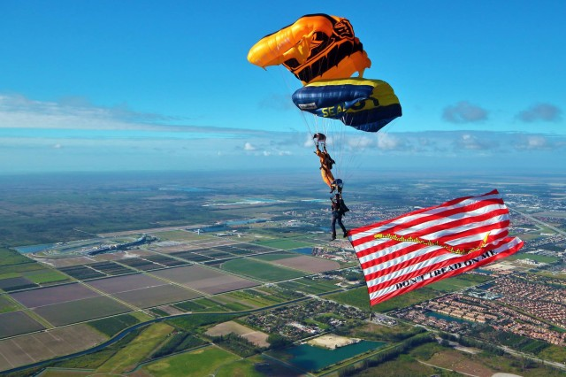 "Members of the U.S. Army Parachute Team ""Golden Knights"" and the U.S. Navy Parachute Team ""The Leap Frogs"" train together on canopy relative work over Homestead Air Reserve Base, Fla., February 22, 2016."