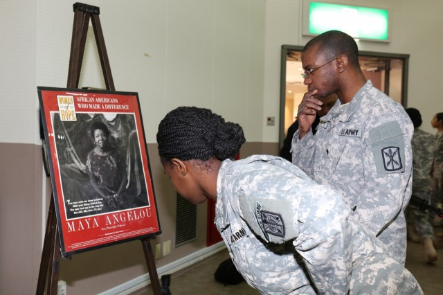Soldiers look at graphic image displays at during the Camp Zama Black History Month Observance held Feb 18, at the Camp Zama Community Activity Center. (U.S. Army photo by Alia Naffouj)