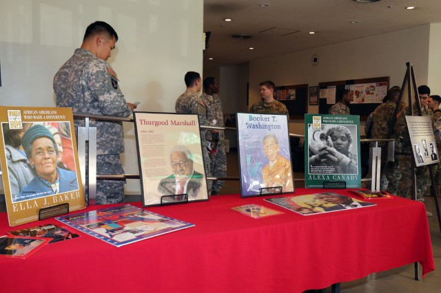 Graphic images depicting several accomplished African Americans that impacted US history were on display during the Camp Zama Black History Month Observance held Feb 18, at the Camp Zama Community Activity Center. (U.S. Army photo by Alia Naffouj)