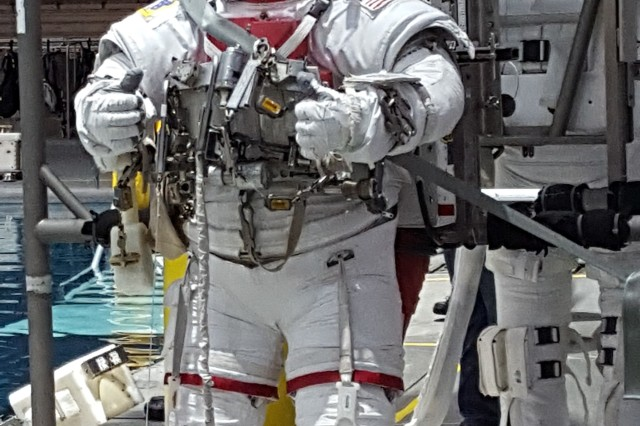 Army astronaut Col. Mark Vande Hei enters the Neutral Buoyancy Lab, Feb. 8, for training at NASA Johnson Space Center.