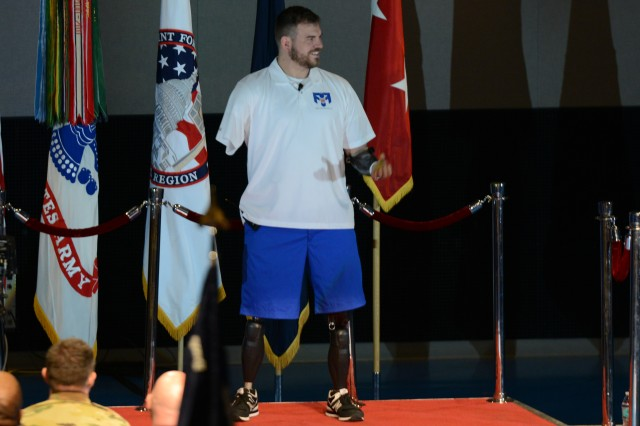 Retired Staff Sgt. Travis Mills talks to hundreds of Soldiers about resilience, Feb. 9, 2016, at a U.S. Military District of Washington-sponsored program at Conmy Hall, Joint Base Myer-Henderson Hall. The former 82nd Airborne Soldier is now an advocate for veterans and disabled service members worldwide.