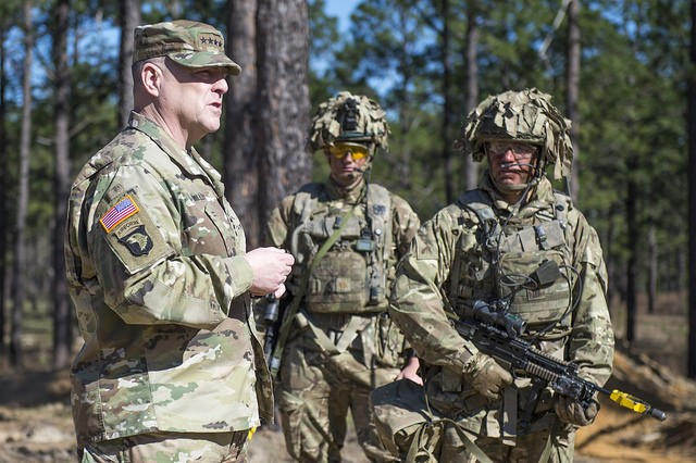 U.S. Army Chief of Staff, Gen. Mark A. Milley (left), talks with soldiers serving with forces from the United Kingdom during their training at the Joint Readiness Training Center (JRTC), Fort Polk, La., Feb. 26, 2016. Milley talked about the importance of the UK partnership, strengthening the militaries' relationships, and furthering the effectiveness of the coalition force. (U.S. Army photograph by Staff Sgt. Chuck Burden / released)