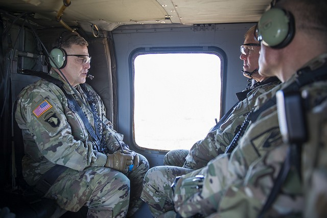 U.S. Army Chief of Staff, Gen. Mark A. Milley (left), talks with Brig. Gen. Timothy P. McGuire, commander of the Joint Readiness Training Center (JRTC), during a flight over Fort Polk, La., Feb. 26, 2016. Milley challenged the leaders of JRTC to diligently prepare forces to respond in a complex global environment. (U.S. Army photograph by Staff Sgt. Chuck Burden /released)