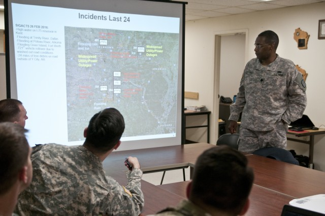 U.S. Army Reserve Soldiers with the 961st Engineer Battalion, provide a command update brief to Lt. Col. Maynard Spell, commander, 961st Engineer Battalion, during the 961st Engineer Battalion's third Defense Support of Civil Authorities tabletop exercise in Seagoville, Texas, Feb. 25 to 28. (U.S. Army photo by Staff Sgt. Debralee Best)