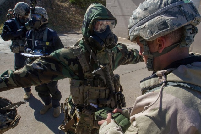 Paratroopers conduct chemical decontamination training