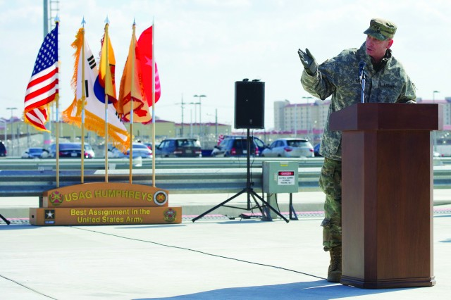 Maj. Gen. Theodore D. Martin, 2nd Infantry Division commanding general motions towards the ribbon to officially open the Humphreys Railhead.