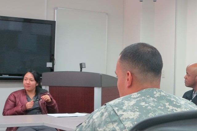 Ms. Jacklynn Graham, Staff Registered Nurse, participates with other nursing staff members at Brig. Gen. Crawford Sams U.S. Army Health Clinic (a.k.a. MEDDAC-Japan), discussing a peer reviewed article on immunizations, as a part of Nurse Grand Rounds, at Camp Zama, Japan, on Feb. 23, 2016.