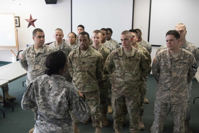 Soldiers from all around the 1st Cavalry Division rehearses a scene involving a unit formation in a Sexual Assault/Sexual Harassment Awareness skit at the 3rd Cavalry Regiment's Soldier and Family Readiness Center at Fort Hood, Texas. The skit is a collaboration of all the First Team units and is meant to provide a more interactive training opportunity that the standard classroom instruction. (U.S. Army photo by Staff Sgt. Leah R. Kilpatrick, 3rd ABCT PAO/released)