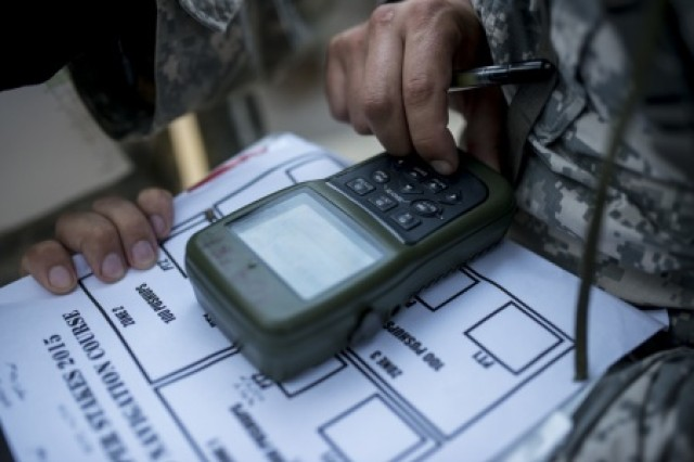 U.S. Army Reserve combat engineers from the 374th Engineer Company (Sapper), of Concord, Calif., write down and program their grid coordinates using a Defense Advanced GPS receiver during a team-based land navigation course during the 2015 Sapper Stakes competition at Fort Chaffee, Ark., Aug. 30.