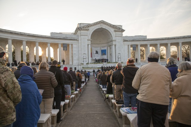 Hundreds of visitors to Arlington National Cemetery's Memorial Amphitheater watched the sunrise during the annual Easter Sunrise Service, April 5, 2015. This year's Easter Sunrise Service takes place March 27.