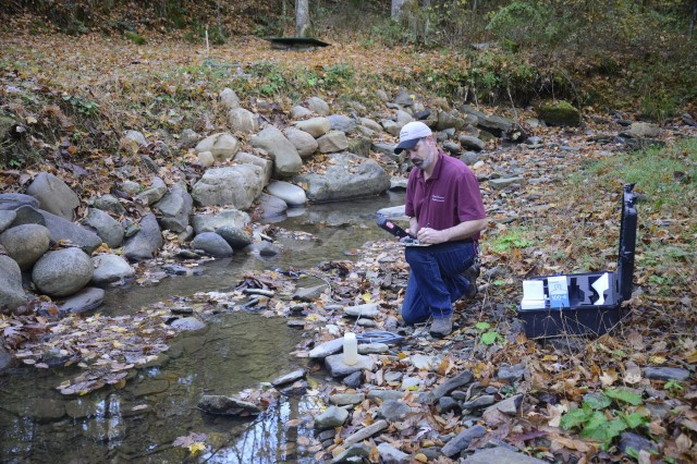 Camp Dawson natural resources staff measure water quality parameters and flow data to delineate potential contaminants and establish trend lines for the region.