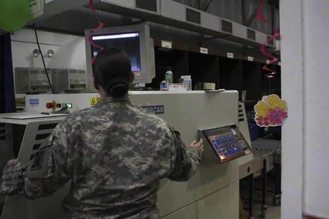 "Sgt. Kelli Norman, a finance clerk from the 912th Human Resources Command Postal Team, out of Orlando, Fla., runs a package through an X-ray machine at Camp Bondsteel, Kosovo, post office during a Feb. 27, 2016, postal ""rodeo"" for redeploying Soldiers. The troops provided free food and longer postal hours to encourage Soldiers preparing to return home to mail packages early and avoid the last-minute rush. The post office mails over 200 packages and letters a day and serves not only Camp Bondsteel, but also Soldiers assigned to MNBG-E's Forward Command Post at Camp Marechal de Lattre de Tassigny. (U.S. Army photo by Sgt. Gina Russell, Multinational Battle Group-East)"