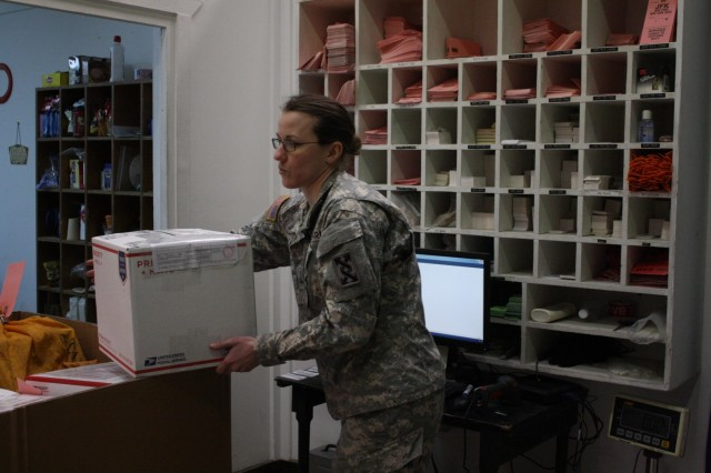 "Cpl. Laurel Geist, the noncommissioned officer in charge of operations for the 912th Human Resources Command Postal Team, out of Orlando, Fla., enters package information into a computer during a Feb. 27, 2016, postal ""rodeo"" at the post office on Camp Bondsteel, Kosovo. The troops provided free food and longer postal hours to encourage Soldiers preparing to return home to mail packages early and avoid the last-minute rush. The post office mails over 200 packages and letters a day and serves not only Camp Bondsteel, but also Soldiers assigned to MNBG-E's Forward Command Post at Camp Marechal de Lattre de Tassigny. (U.S. Army photo by Sgt. Gina Russell, Multinational Battle Group-East)"