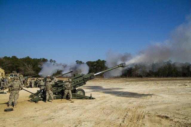 Soldiers from 3rd Infantry Division Artillery fire M77A2 Howitzers during a Mass Fire Mission on Fort Stewart, Ga., March 1. It was the first time Division Artillery teamed with Company E, 3rd Combat Aviation Brigade who provided the services of the MQ-1C Gray Eagle unmanned aerial system to provide target identification, observing the rounds as they are fired, and assessing battle damage.
