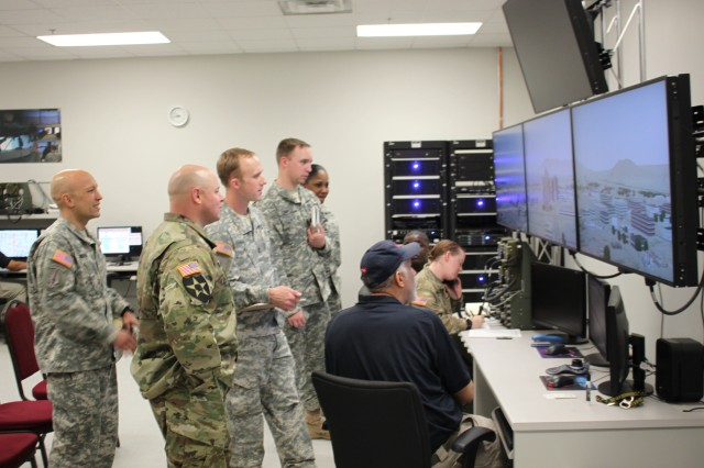 Army officers monitor and evaluate the action