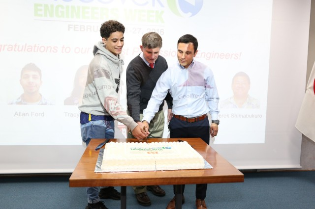 Jose Santana, left, junior at ZAHS, helps Mark Jones, center, chief of engineering division, and Donnie Osborne, right, civil engineer, cut the cake after the recognition ceremony held, Feb. 22, at USACE Japan District.