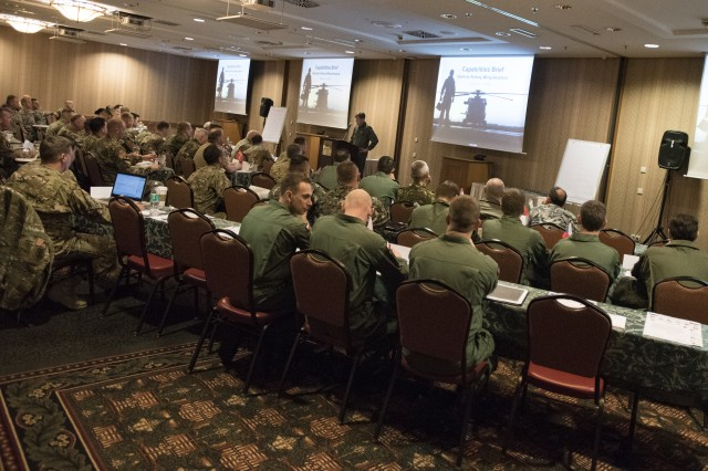 Lt. Col. Axel Sentker, Gruppe Grundsatz, Germany, briefs attendees of the first annual Strong Europe Aviation Rotary Wing Summit at the Edelweiss Lodge and Resort conference center, Garmisch-Partenkirchen, Germany Mar. 1-2, 2016.  The conference, hosted by the 12th Combat Aviation Brigade, was aimed at gathering Aviators from all over Europe in order to build common understanding, establish future joint training, and develop habitual relationships and partnerships between the Allied nations.