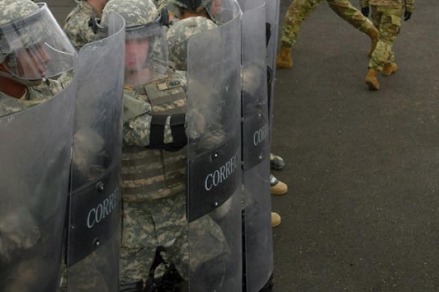 Soldiers, training to be corrections and detention specialists, run through a mock-riot scenario with instructors playing the part of rioters during advanced individual training. Upon graduation, these Soldiers are likely to be stationed at one of six Army or joint-service corrections or detention facilities.