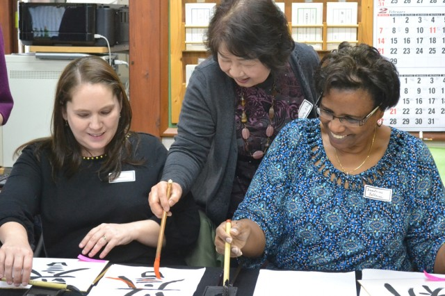 ZaCSA members learn how to make Japanese kanji characters of their own during a Calligraphy Workshop, the last cultural event of the 2015-16 ZaCSA membership year. (U.S. Army photo by Melanie Kincaid)