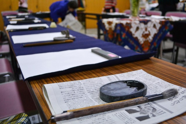 Brush, paint and paper sets used to show ZaCSA members how to make Japanese kanji characters of their own during a Calligraphy Workshop, the last cultural event of the 2015-16 ZaCSA membership year. (U.S. Army photo by Nano Betts)