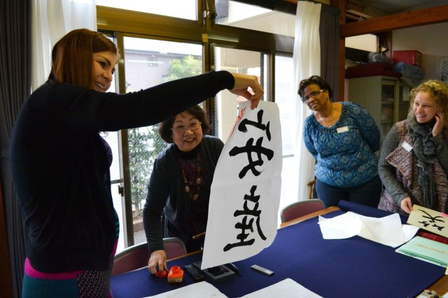 ZaCSA and Japanese Friendship Group members admire one member's finished artwork during a Calligraphy Workshop, the last cultural event of the 2015-16 ZaCSA membership year. (U.S. Army photo by Nano Betts)